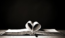 Bible with pages in heart