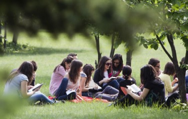 33075624 - sofia, bulgaria - may 11, 2012: student are reading in a park in front of their university. the initiative is willing to show the society that the students are motivated to study hard and the education is the main reason for getting into university.